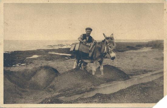 Sion,  le ramassage du sable et des cailloux.